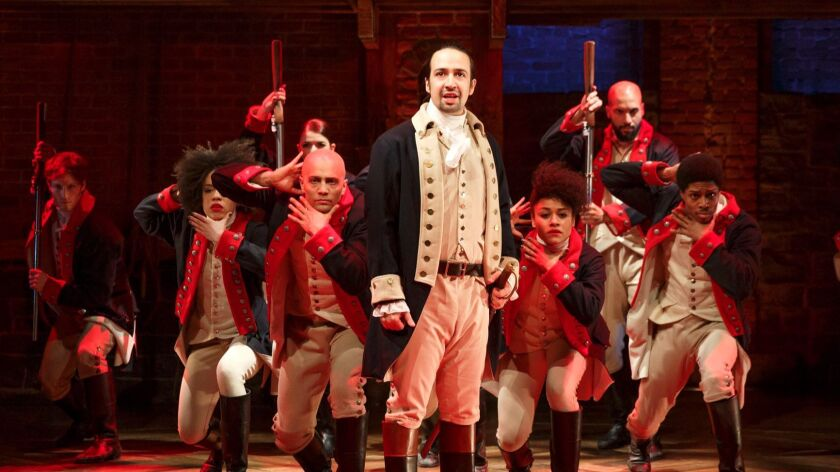 """Lin-Manuel Miranda performs with members of the cast of the musical """"Hamilton"""" in New York."""