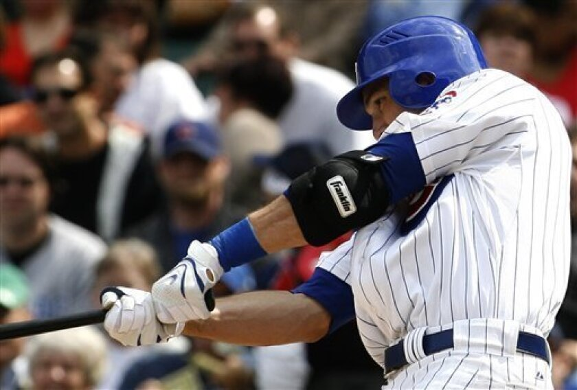 Chicago Cubs' Mark DeRosa hits an RBI single against Pittsburgh Pirates during the fourth inning of a baseball game on Friday, April 18, 2008 in Chicago. (AP Photo/Nam Y. Huh)