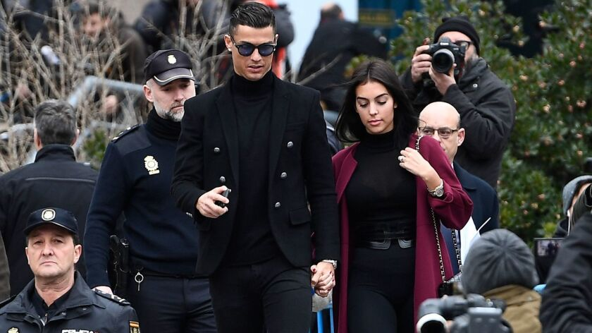 Cristiano Ronaldo leaves with girlfriend Georgina Rodriguez after attending a court hearing for tax evasion in Madrid on Jan. 22.