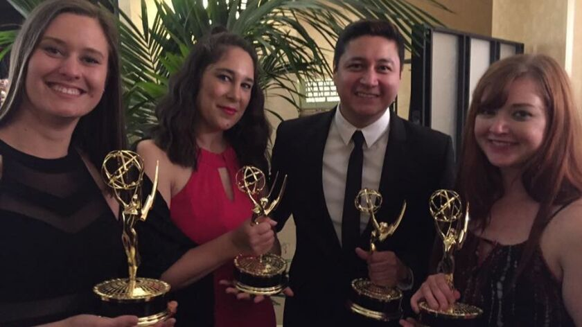Union-Tribune staffers after winning Pacific Southwest Emmy awards. From left to right: Lauren Flynn
