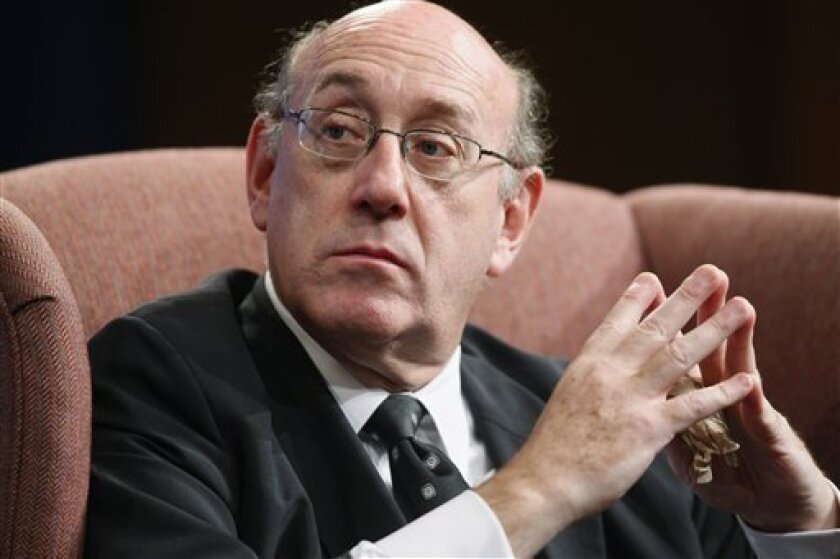 """FILE - In this Oct. 27, 2009 file photo, Special Master for Executive Compensation Kenneth Feinberg, also known as the Treasury Department's """"pay czar"""", speaks during a discussion at Georgetown Law Center in Washington. Executives in AIG's financial products division are getting $100 million richer Wednesday, Feb. 3, 2010, and the White House pay czar calls the bonuses """"outrageous.""""(AP Photo/Charles Dharapak, file)"""