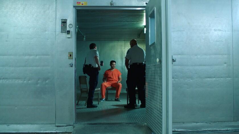 "Juan Gabriel Pareja, center, in the movie ""The Infiltrators."""