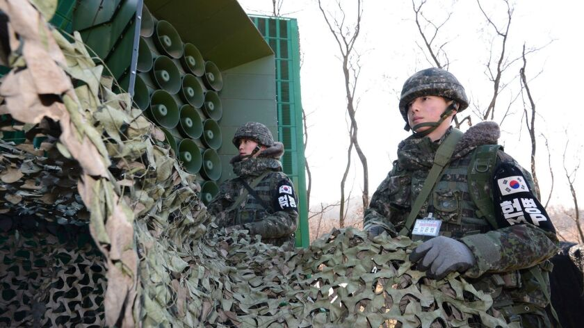 South Korean soldiers remove camouflage from loudspeakers near the border with North Korea in Yeoncheon, South Korea, in 2016.