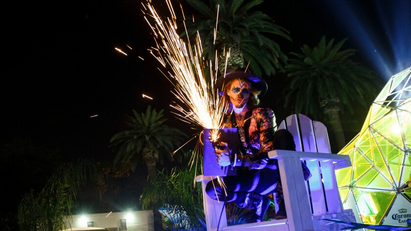 Hard Day of the Dead will not be held in 2016, organizers confirmed. In this file photo, Kahill Head uses a grinder to make sparks as music fans attend the Halloween-themed rave at the Pomona Fairplex on Oct. 31, 2015.