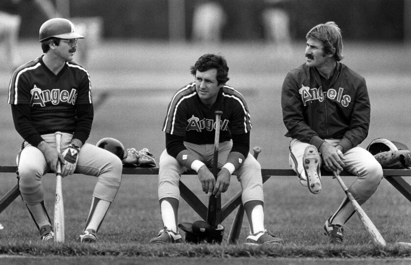 Angels Tim Foli, left, Fred Lynn and Bobby Grich chat between batting practice during spring training in March 1983.