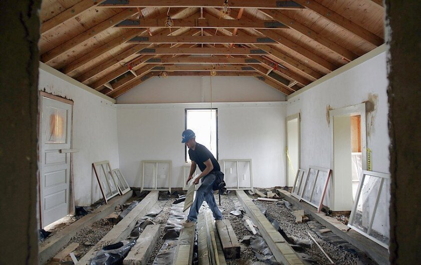 Carpenter Chad Shively works on the restoration of the Sikes Adobe Historic Farmstead in Escondido. The adobe home, built in 1872, burned in the 2007 wildfires.