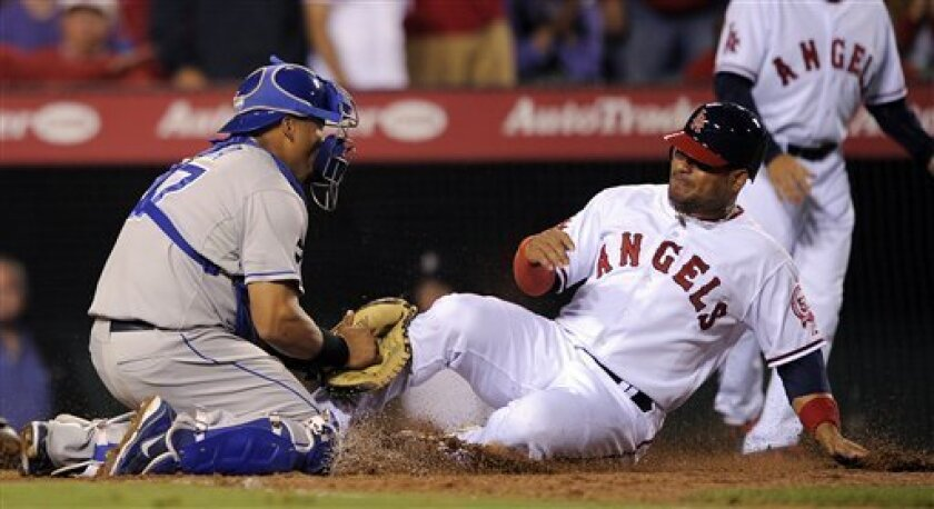 Los Angeles Angels' Bobby Abreu, right, is tagged out at home by Kansas City Royals catcher Brayan Pena as he tries to score on a single by Erick Aybar during the sixth inning of their baseball game, Friday, June 10, 2011, in Anaheim, Calif. (AP Photo/Mark J. Terrill)