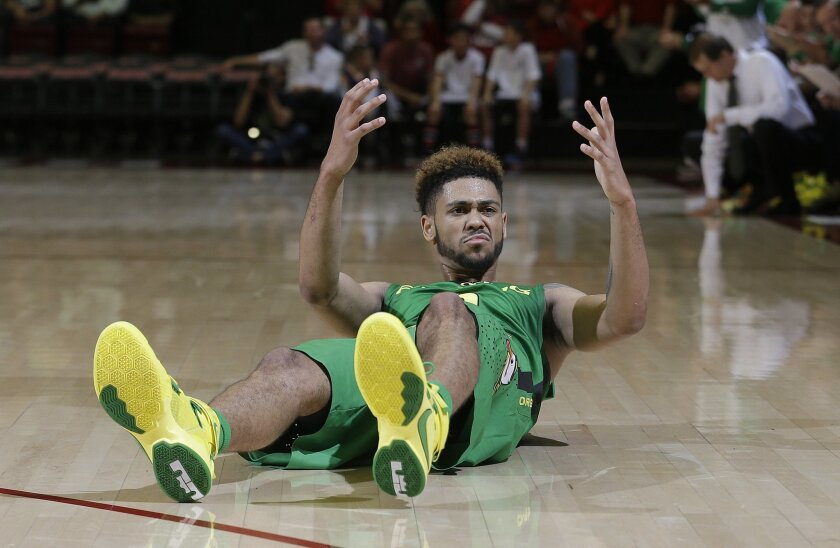 Oregon's Tyler Dorsey (5) reacts after hitting the ground during the first half of an NCAA college basketball game against Stanford in Stanford, Calif., Saturday, Feb. 13, 2016. Stanford won 76-72. (AP Photo/Jeff Chiu)