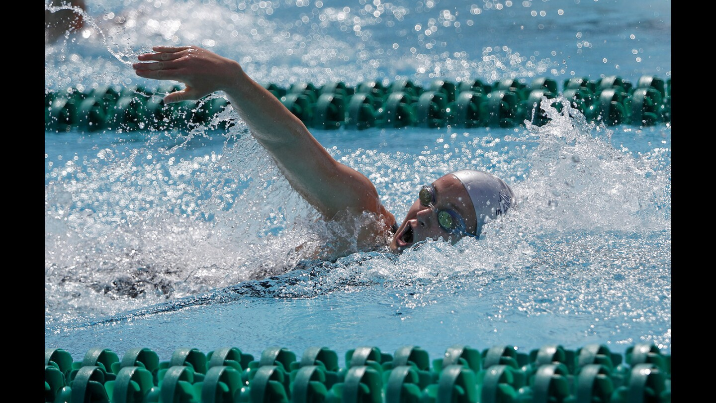 Newport Harbor High's Ayla Spitz competes in the girls' 200-yard freestyle race during the Sunset League finals at Golden West College in Huntington Beach on Friday, May 4. Spitz placed first with a time of 1:45.44.