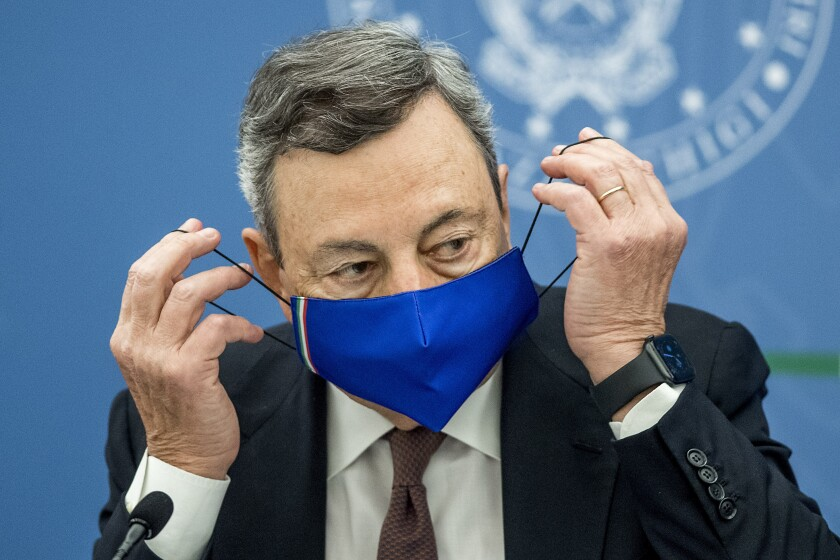 """Italian Premier Mario Draghi attends a press conference at Chigi Palace government office in Rome, Thursday, July 22, 2021. With COVID-19 cases rising again, Italy will start requiring people to have a so-called """"green pass"""" to access venues like gyms, museums and indoor restaurants. Certification that one is vaccinated, has recovered from COVID-19 in the last six months or tested negative in the previous 48 hours will let people dine at indoor restaurants, go to movies, sports events, casinos and other indoor recreational venues. (Roberto Monaldo/LaPresse via AP)"""
