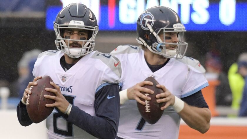 Tennessee Titans quarterback Marcus Mariota (8) and quarterback Blaine Gabbert (7) work out prior to a game against the New York Giants on Dec. 16, 2018, in East Rutherford, N.J.