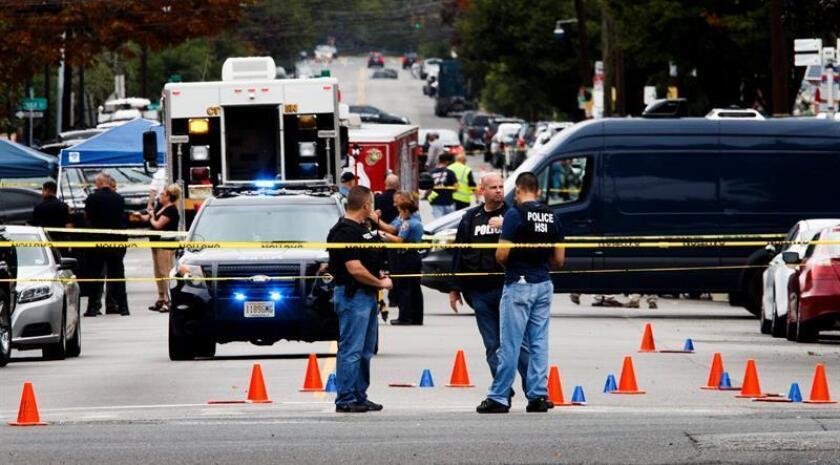 Oficiales de policía y agentes del FBI trabajan en la escena de un tiroteo Ahmad Khan Rahami (NJ, EE.UU.). EFE/Archivo