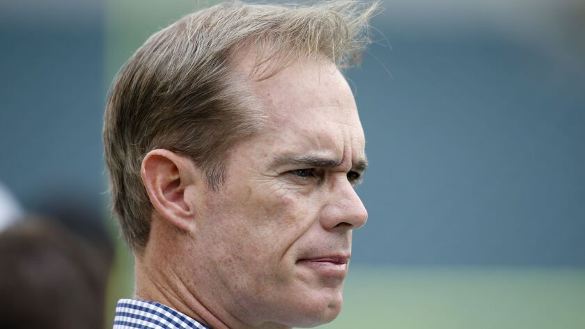 Fox sportscaster Joe Buck watches pregame warmups.