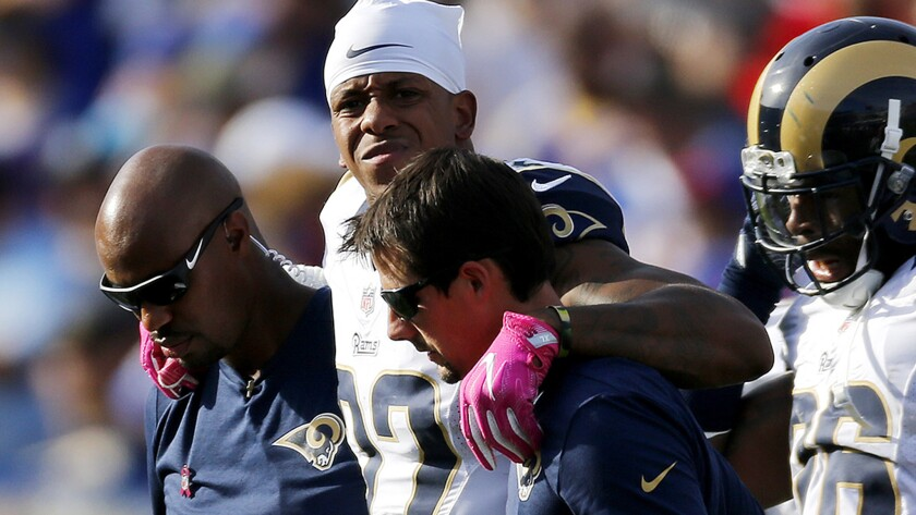 Rams cornerback Trumaine Johnson is helped off the field after suffering an ankle injury Sunday while playing against the Buffalo Bills.