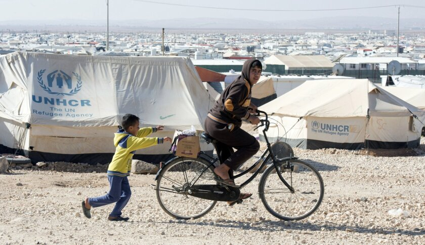 Young Syrians play in the Zaatari refugee camp in Jordan in 2015.