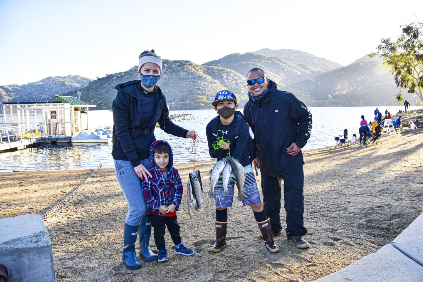 Tia, August, Kayden and Shaun Cassion. Kayden shows his catch after fishing for an hour.