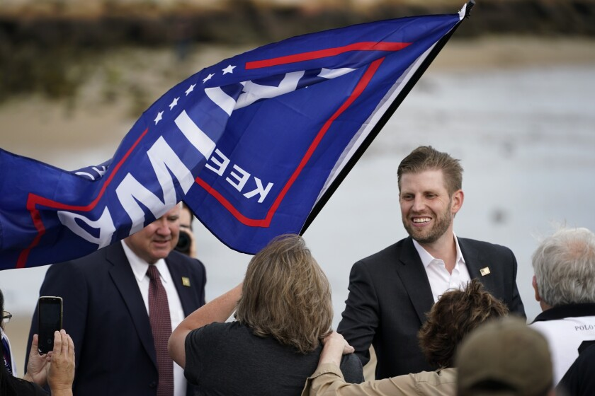 Eric Trump greets supporters at a campaign rally.