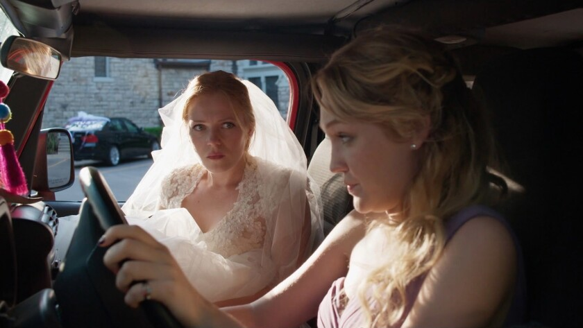 """Emma Bell, left, and Hope Lauren in the movie """"Different Flowers."""""""
