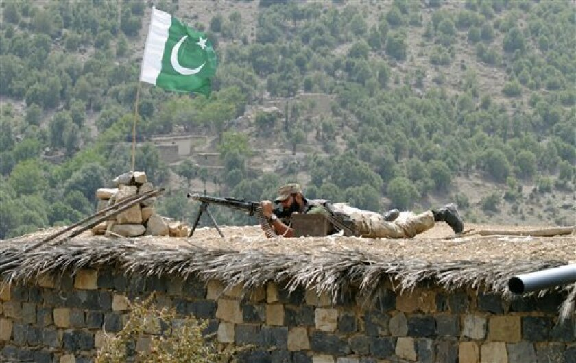 A Pakistani army soldier takes a position during a military operation against militants in Pakistan's Khurram tribal region, Sunday, July 10, 2011. A military operation in Kurram tribal region has been launched to clear the area of terrorists involved in various terrorist activities, including kidnapping and killing of locals, suicide attacks and blocking the road connecting Lower with upper Kurram, Pakistani army spokesman Maj. Gen. Athar Abbas said. (AP Photo/Mohammad Zubair)