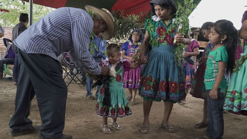 A christening party for Valentina Lopez, 3, in San Miguel del Valle, Oaxaca, which has long sent migrants to the U.S., including Valentina's father. He was in California until he returned several years ago.