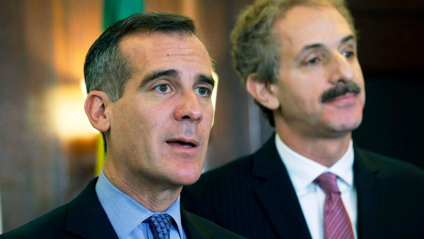 Los Angeles Mayor Eric Garcetti, left, and City Atty. Mike Feuer