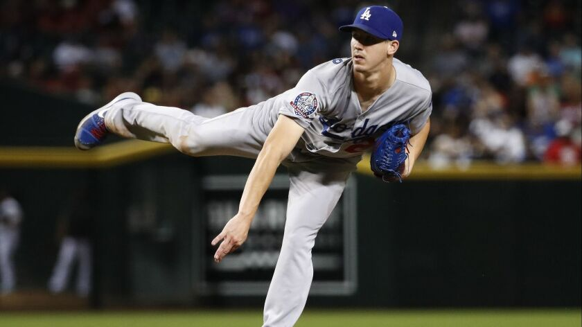 Dodgers starting pitcher Walker Buehler throws against the Arizona Diamondbacks during the sixth inning on Tuesday in Phoenix.