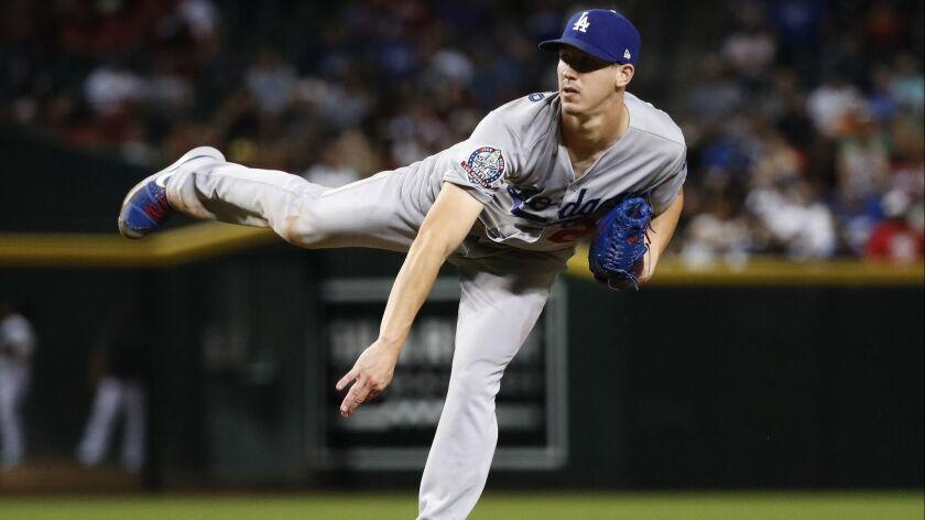 Los Angeles Dodgers starting pitcher Walker Buehler throws to an Arizona Diamondbacks batter during