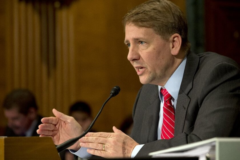 RMK Financial Corp. agreed to pay $250,000 to settle Consumer Financial Protection Bureau accusations of deceptive advertising. Above, the bureau's director, Richard Cordray, testifies before Congress.