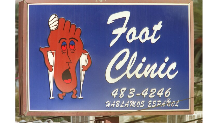 The revolving Happy Food Sad Foot Sign has stood at the corner of Sunset Boulevard and Benton Way in Echo Park since 1985. It will be moved to a new location in September.