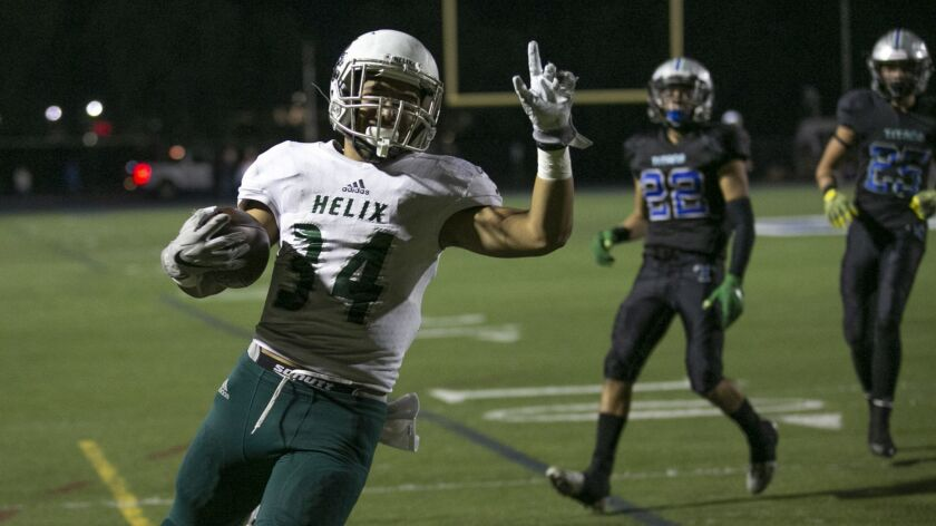 Helix running back Elelyon Noa, who has 2,180 yards rushing this season, will try to find an opening in the St. Augustine defense.