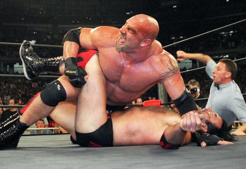 World Championship Wrestling heavyweight Bill Goldberg puts Scott Hall to the mat during a WCW match July 6, 1998 in Atlanta.