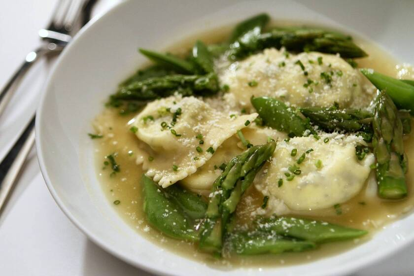 Spring vegetables in Parmesan broth with goat cheese ravioli.