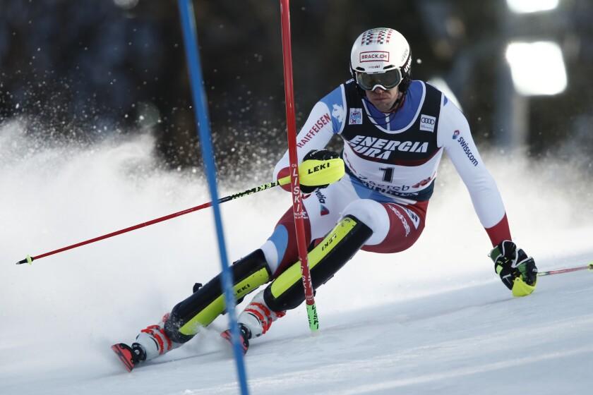 Switzerland's Ramon Zenhaeusern competes during an alpine ski, men's World Cup slalom in Zagreb, Croatia, Sunday, Jan. 5, 2020. (AP Photo/Gabriele Facciotti)