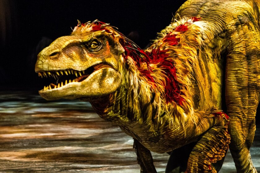 "This image released by Boneau/Bryan-Brown shows a lifelike dinosaur, part of the ""Walking with Dinosaurs, the Arena Spectacular,"" in New York. The show, based on an award-winning BBC Television series, travels 200 million years from Triassic to the Jurassic and Cretaceous periods, and features 10 species of dinosaur. It is produced by Global Creatures, the Australian company behind the new musical ""King Kong,"" the Tony Award-winning ''War Horse"" and ""How To Train Your Dragon."" (AP Photo/Boneau/Bryan-Brown, Patrick Murphy)"