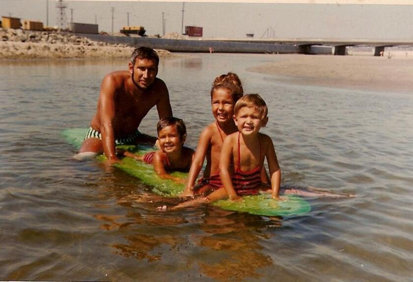 On surfboards since their childhood days: Family beach day with sisters Izzy, Coco, Valerie and their father, Paul