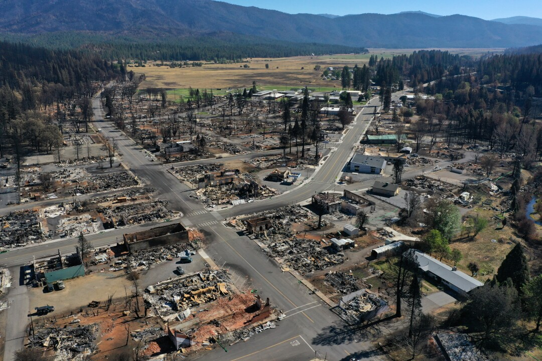 In an aerial view, the remains of homes and businesses destroyed by the Dixie Fire are visible