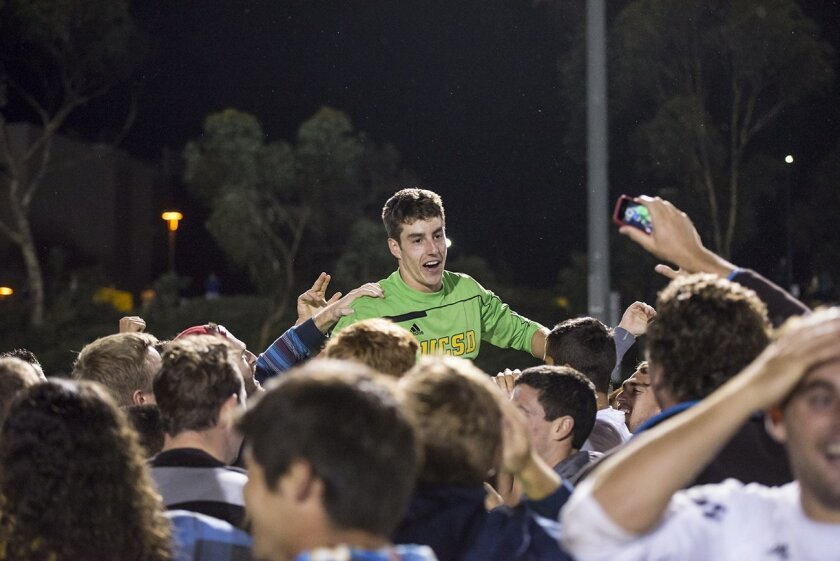 Fans lift UCSD goalie Josh Cohen after he made three great saves to lead the Tritons to a victory in penalty kicks over Chico State.