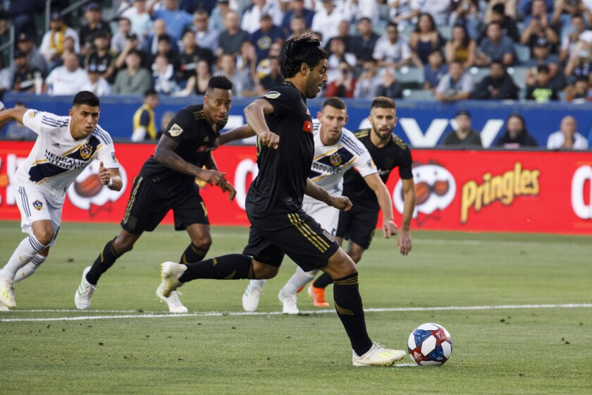 LAFC forward Carlos Vela (10) takes a penalty kick to score a goal during the first half of a match against the Galaxy on July 19, 2019 in Carson.