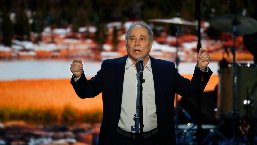 "Paul Simon performs ""Bridge Over Troubled Waters"" on the first night of the Democratic National Convention on Monday, July 25, 2016."