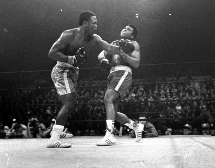 FILE - In this March 8, 1971, file photo, boxer Joe Frazier, left, hits Muhammad Ali during the 15th round of their heavyweight title fight at New York's Madison Square Garden.  Can the Mayweather-Pacquiao  fight ever live up to its hype? Comparing this fight to other great matches in history that