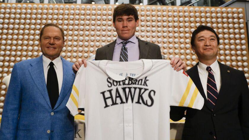 Sports agent Scott Boras, left, SoftBank Hawks pitcher Carter Stewart Jr., center, and Hawks General