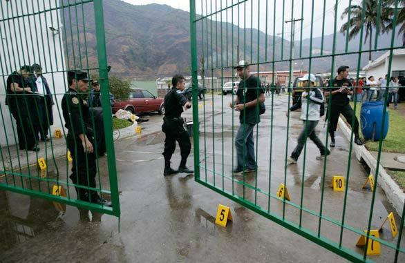 Police investigate the scene of an ambush of Guatemalan anti-drug agents in an industrial park in Amatitlan, about 20 miles from the nation's capital, Guatemala City.