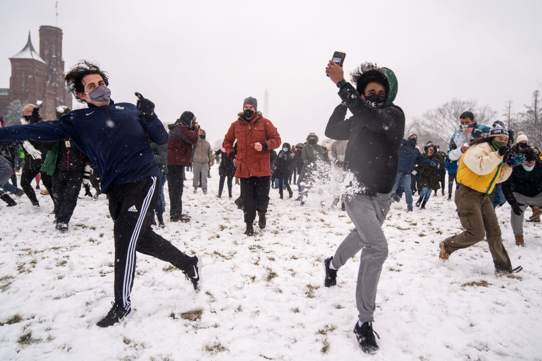 People take part in a snowball fight