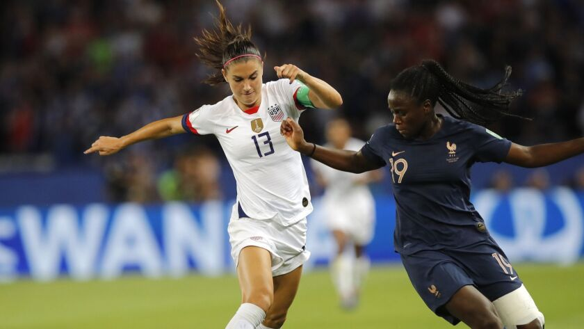 United States' Alex Morgan, left, takes on France's Griedge Mbock Bathy during the Women's World Cup