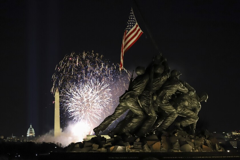Fireworks explode over the Washington Monument as part of festivities after President Biden's inauguration.