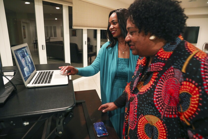 Dr. Akilah Weber and her mother, Secretary of State Shirley Weber, check results for the 79th Assembly district race