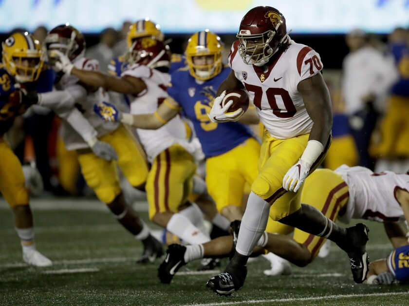 USC's Jalen McKenzie carries the ball during the first quarter.