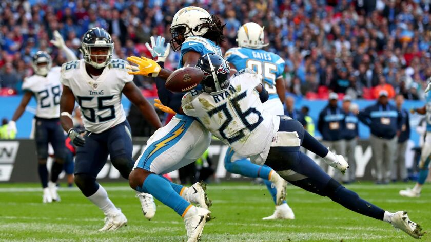 The Chargers' Tyrell Williams is denied a touchdown by the Tennessee Titans' Logan Ryan during an Oct. 21 game at Wembley Stadium in London.
