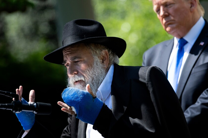 Poway Rabbi Yisroel Goldstein, with President Donald Trump, spoke during the National Day of Prayer service in the Rose Garden of the White House on May 2, 2019. His bandaged hands bear wounds from the deadly shooting that had occurred five days earlier at the Chabad of Poway synagogue.