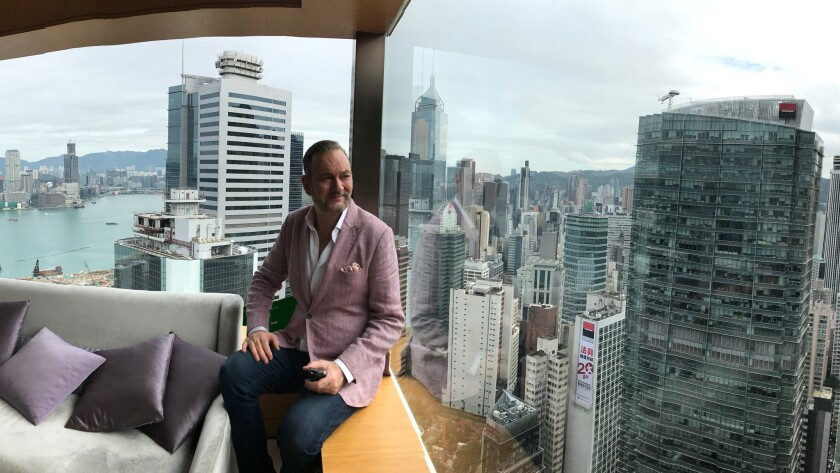 Author Lawrence Osborne taking in the view at The Upper House in Hong Kong. Lawrence Osborne has a